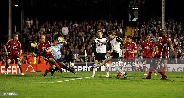 Zoltan Gera of Fulham shoots and scores his teams second goal during the UEFA Europa League SemiFinal 2nd leg match between Fulham and Hamburger SV...
