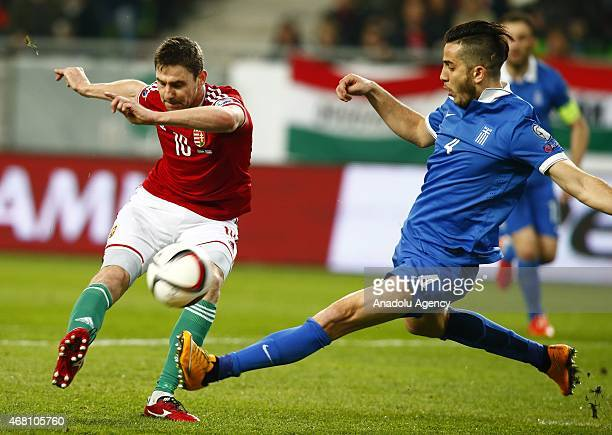 Zoltan Gera of Hungary is challenged by Kostas Manolas of Greece during Hungary v Greece European Euro 2016 qualification soccer match at Grupama...