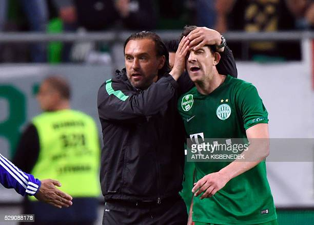 Zoltan Gera of TC Frerencvaros celebrates his score his German coach Thomas Doll during the Hungarian Cup final football match against FC Ujpest at...
