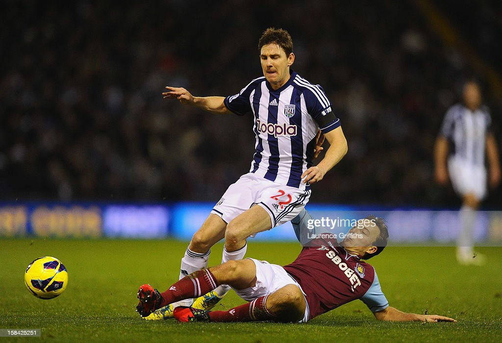 Zoltan Gera of West Bromwich Albion battles with Mark Noble of West Ham United during the Barclays Premiership match between West Bromwich Albion and West Ham United at The Hawthorns on December 16, 2012 in West Bromwich, England.
