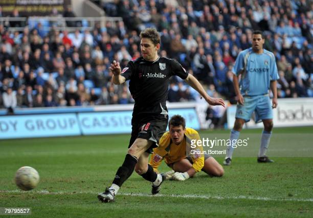 Zoltan Gera of West Bromwich Albion rounds Andy Marshall the Coventry City goalkeeper to score the 5th goal during FA Cup Sponsored by Eon 5th Round...