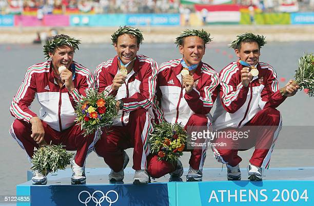 Zoltan Kammerer Botond Storcz Akos Vereckei and Gabor Horvath of Hungary receive their medals during ceremonies for the men's K4 class 1000 metre...