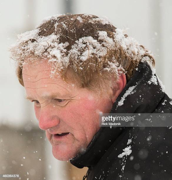 Zoltan Siroki's hair captures falling snow as he shovels the driveway of his workplace on The Queensway in Etobicoke Toronto gets its first taste of...