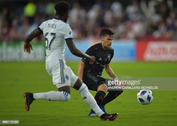 Zoltan Stieber of DC United vies for the ball with Alphonso Davies during the DC United vs the Vancouver Whitecaps FC match in Washington DC on July...