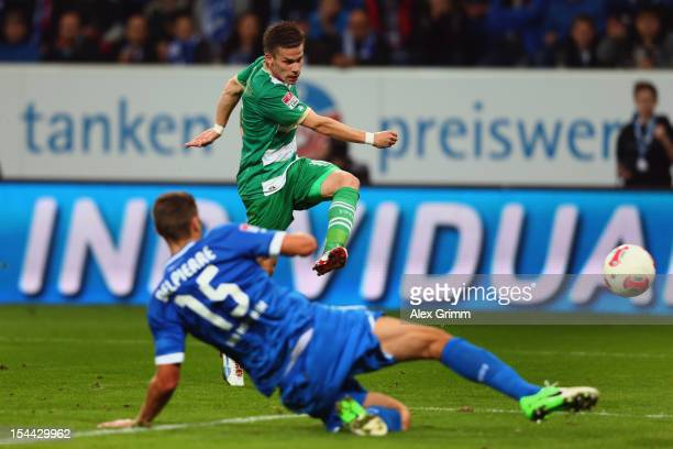 Zoltan Stieber of Greuther Fuerth scores his team's first goal against Matthieu Delpierre of Hoffenheim during the Bundesliga match between 1899...