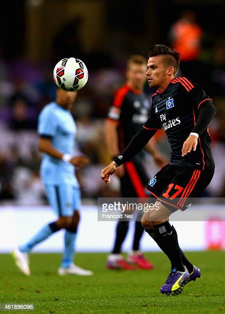 Zoltan Stieber of Hamburg controls the ball during the friendly match between Hamburg SV and Manchester City at Hazza bin Zayed Stadium on January 21...
