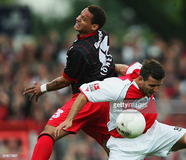 Zoltan Zselesi of Cottbus and Jermaine Jones of Frankfurt battle for a header during the match of the Second Bundesliga between Energie Cottbus and...