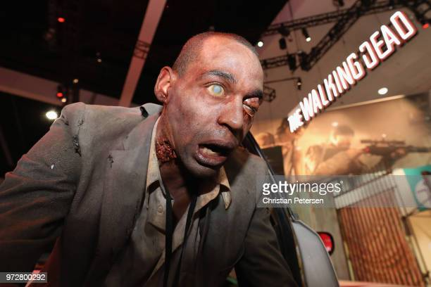 A zombie actor performs at the 'Walking Dead' exhibit during the Electronic Entertainment Expo E3 at the Los Angeles Convention Center on June 12...