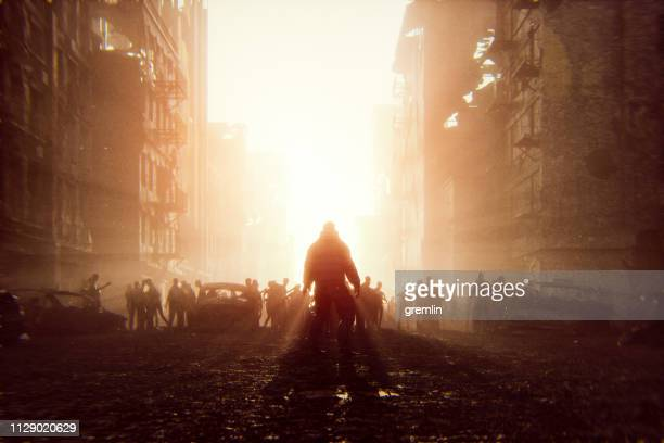 zombie apocalypse survivor against hordes of undead - survival stock pictures, royalty-free photos & images