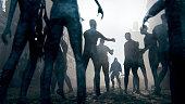 Zombie apocalypse survivor against hordes of undead