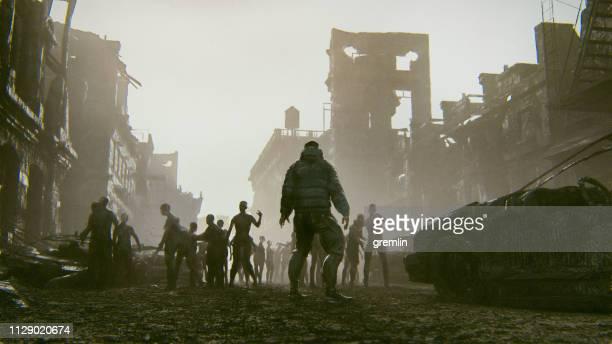 ゾンビ黙示録サバイバーのアンデッドの大群に対して - 残骸 ストックフォトと画像