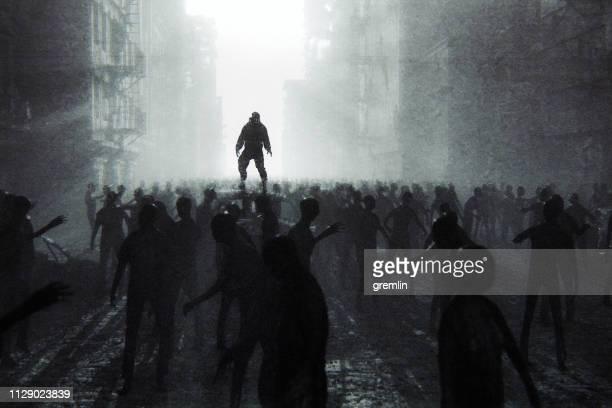zombie apocalypse survivor against hordes of undead - apocalypse stock pictures, royalty-free photos & images