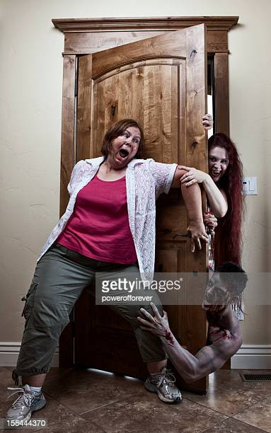 zombie attack - restraining stock pictures, royalty-free photos & images