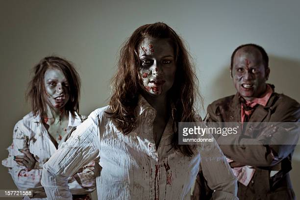 zombie business team - zombie makeup stock photos and pictures