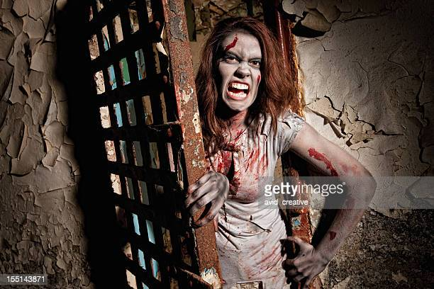 zombie coming out of jail cell door - ugly black women stock photos and pictures