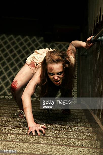 Zombie crawling up stairs