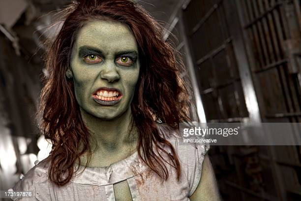 zombie dead girl in jail cell hallway - very ugly women stock photos and pictures
