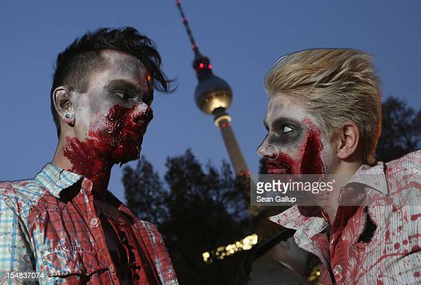 Zombie enthiusiasts gather near the broadcast tower at Alexanderplatz before setting out on a 'Zombie Walk' in the city center on October 27 2012 in...