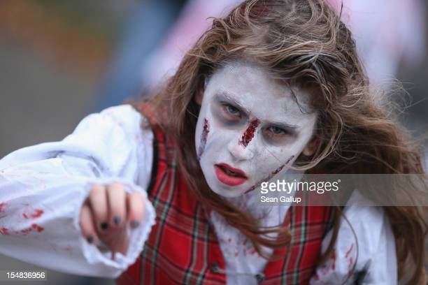 A zombie enthusiast practices being scary before setting out on a 'Zombie Walk' in the city center on October 27 2012 in Berlin Germany Approximately...