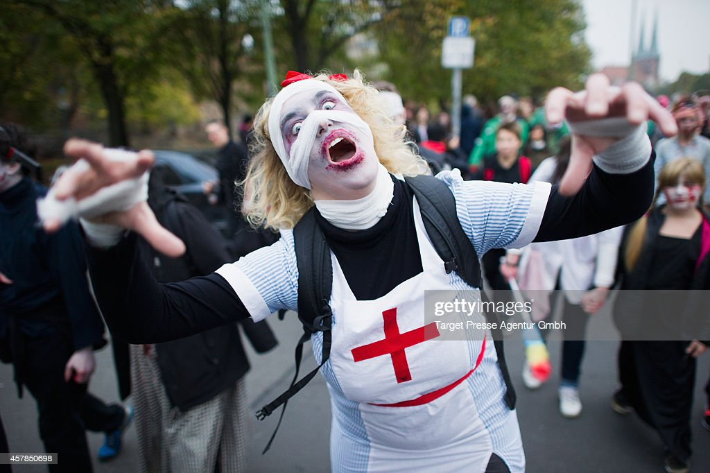 Flash Mob Gathers For Zombie Walk : News Photo
