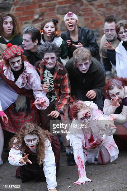 Zombie enthusiasts rehearse a dance before setting out on a 'Zombie Walk' in the city center on October 27 2012 in Berlin Germany Approximately 150...