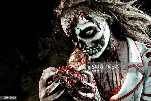 zombie feeding - zombie makeup stock photos and pictures