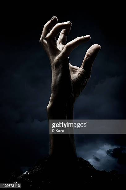 zombie hand - very scary monsters stock photos and pictures