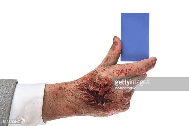 Zombie holding business card