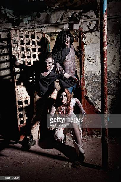 zombie living dead attack - ugly black women stock photos and pictures