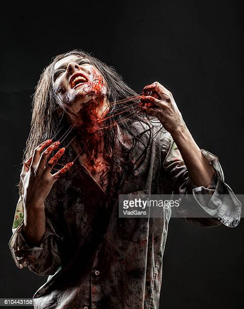 zombie - female corpse stock photos and pictures