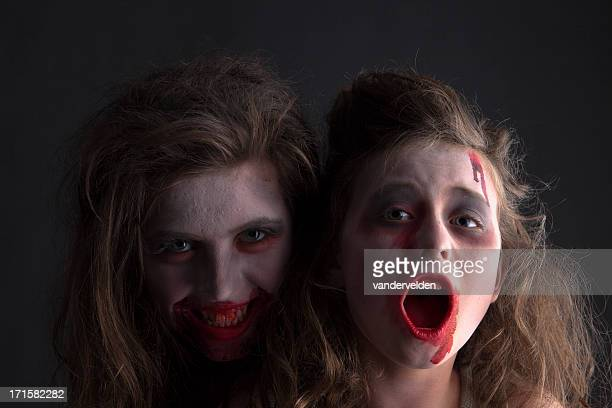 zombie sisters - halloween zombie makeup stock photos and pictures
