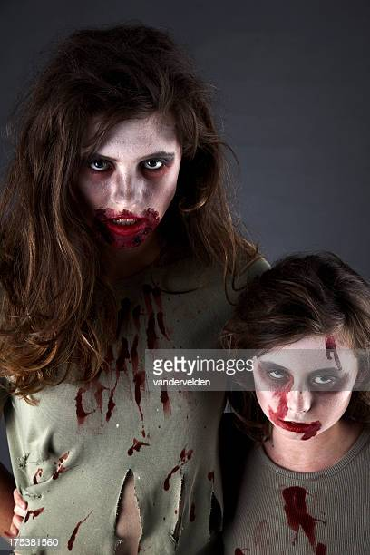 zombie sisters - zombie girl stock photos and pictures