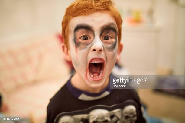 zombie skeleton boy - zombie makeup stock photos and pictures