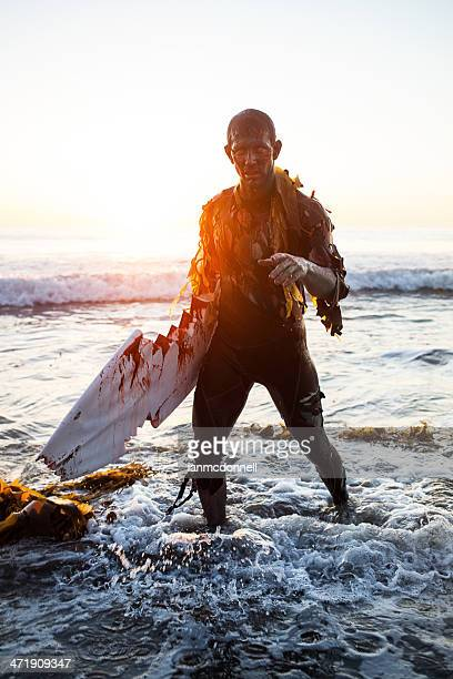 zombie surfer - halloween beach stock photos and pictures