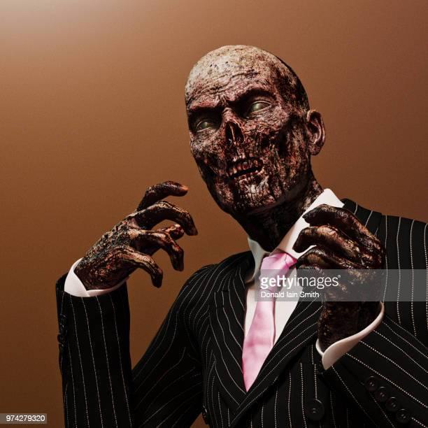Zombie: surreal studio portrait of a zombie businessman in suit and tie