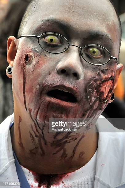 Zombie walk in Toronto traverses Dundas Street from east to west, near a favourite cafe, just before Halloween. While drinking coffee, I saw the...
