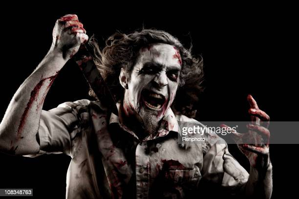 zombie with a knife - zombie makeup stock photos and pictures