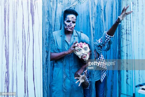 zombies and monsters in halloween haunted house - chokehold stock pictures, royalty-free photos & images