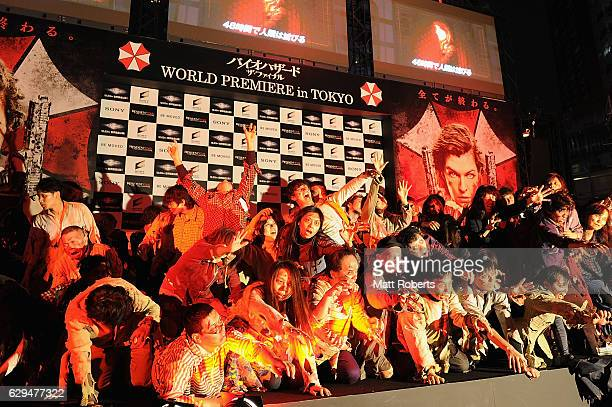 Zombies are seen on stage at the world premiere of 'Resident Evil The Final Chapter' at the Roppongi Hills on December 13 2016 in Tokyo Japan