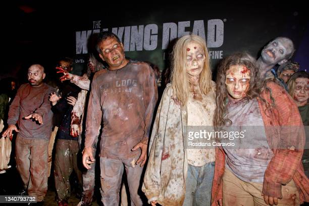 """Zombies attend the photocall of the final season of """"The Walking Dead"""" on September 16, 2021 in Milan, Italy."""
