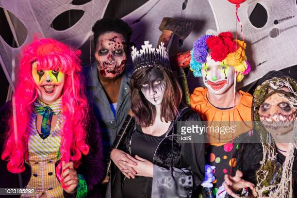 zombies, ghouls and a clown in halloween haunted house - happy halloween stock photos and pictures
