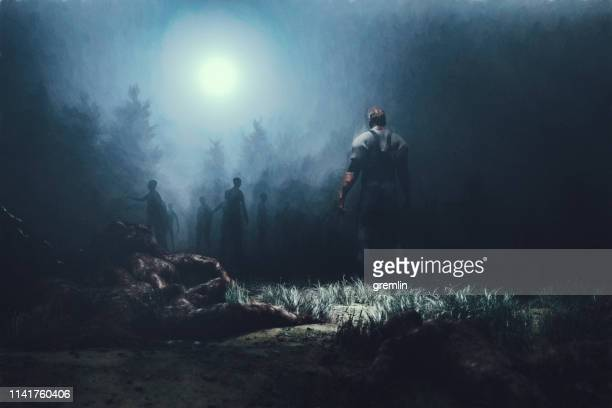 zombies in the forest at night - zombie stock pictures, royalty-free photos & images