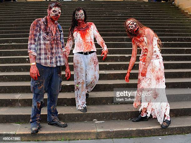 Zombies including makeup artist Cassandra Weatherstone during the Sydney Zombie Walk on October 31 2015 in Sydney Australia