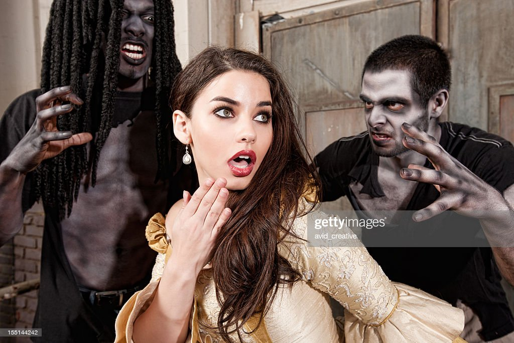 Zombies Sneak Up on Scared Glamour Girl : Stock Photo