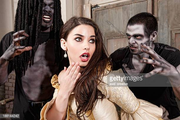 zombies sneak up on scared glamour girl - ugly black women stock photos and pictures