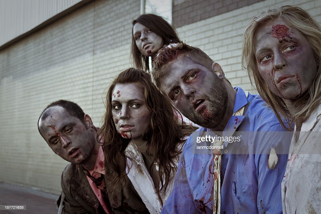 5 zombies staring at something off camera : Stock Photo