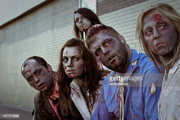 5 zombies staring at something off camera - zombie makeup stock photos and pictures