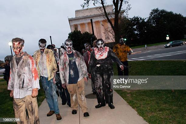 Zombies walk the streets during the Worldwide Zombie Invasion at Lincoln Memorial on October 26 2010 in Washington City
