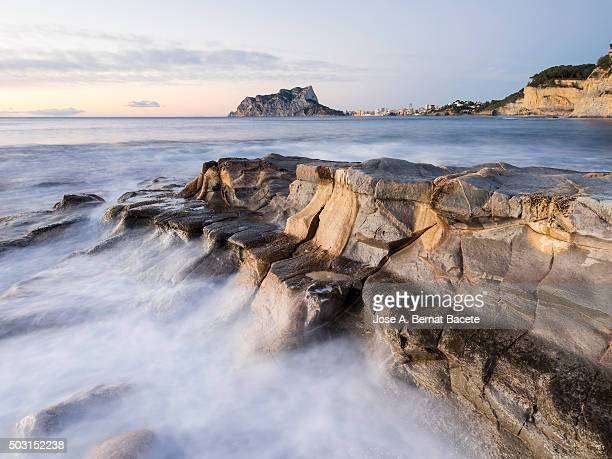 Zone of coast with waves reefs on the rocks to the dawn