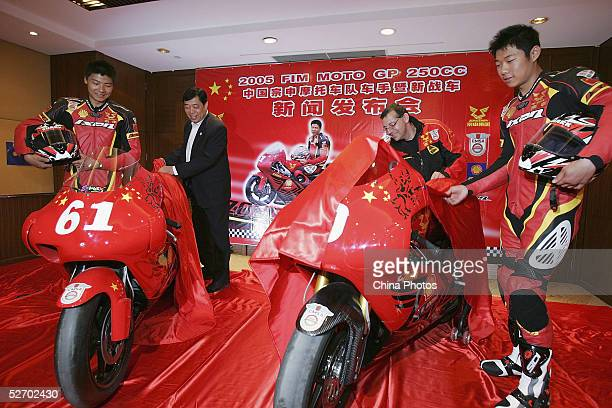 Zongshen motorcycle racing team riders Wang Zhu Li Zhengpeng and manager Michel Marqueton unveil their new racing motors the 'Aprilia RS250' at a...
